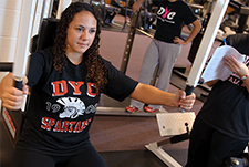 Exercise and Sports studies student in the D'Youville fitness center