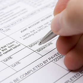 Person filling out a form.