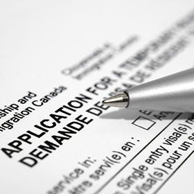 Photo: A pen laid across an application form