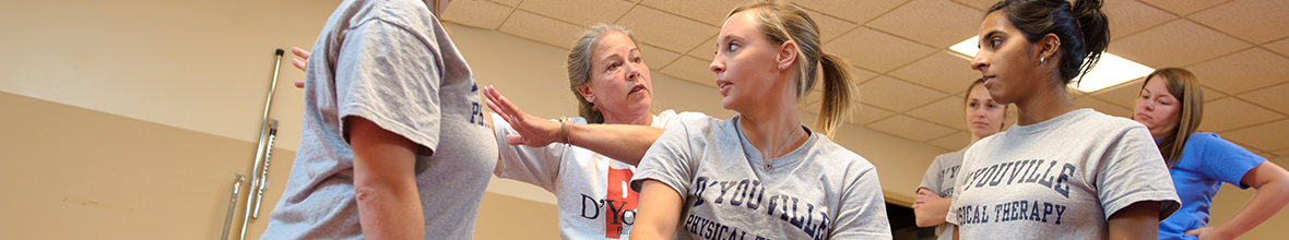 Sarah Pictor working with students in a physical therapy clinical skills lab