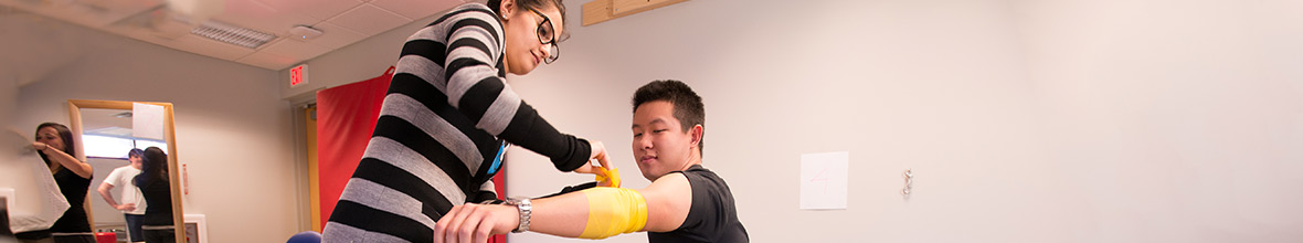 D'Youville students working in a physical therapy lab.