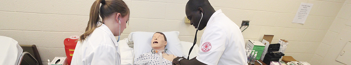 Students practice nursing skills.