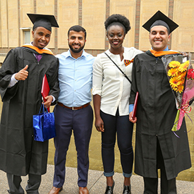 Students pose after having graduated.