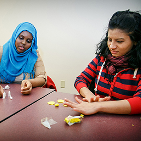 A diverse set of students take part in an activity.