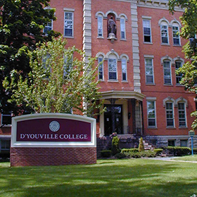 A D'Youville College sign on the college campus.
