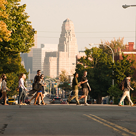 Students cross a street near the DYC campus.