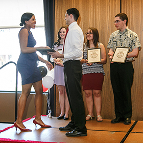 Students receive awards.