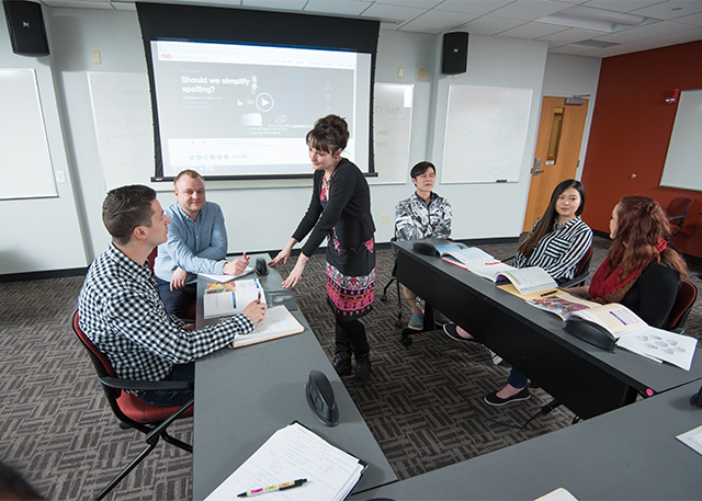 A D'Youville professor instructs a group of students.
