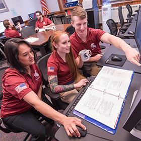 Veteran students work in a computer lab.