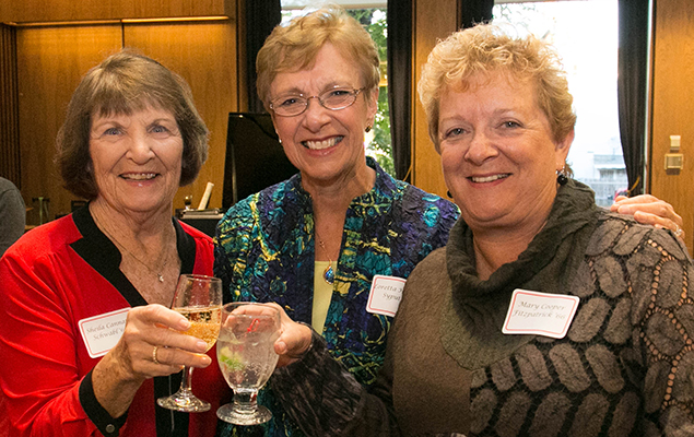 Three members of the class of 1966 toast during the 2016 Red, White, and You weekend.