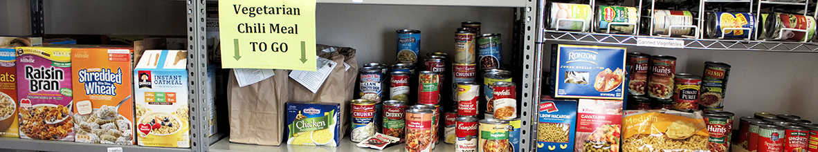 A collection of canned food on shelves.