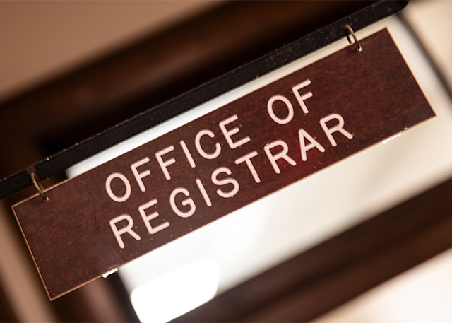 A close-up of the Registrar's sign.