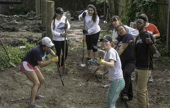 Students helping renovate a yard.