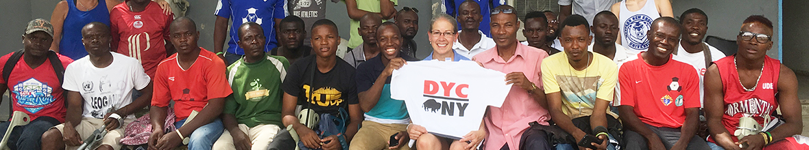 Sarah Pictor poses with a D'Youville shirt in Haiti.
