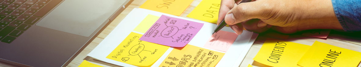 Content strategy using post-it notes to map out ideas.