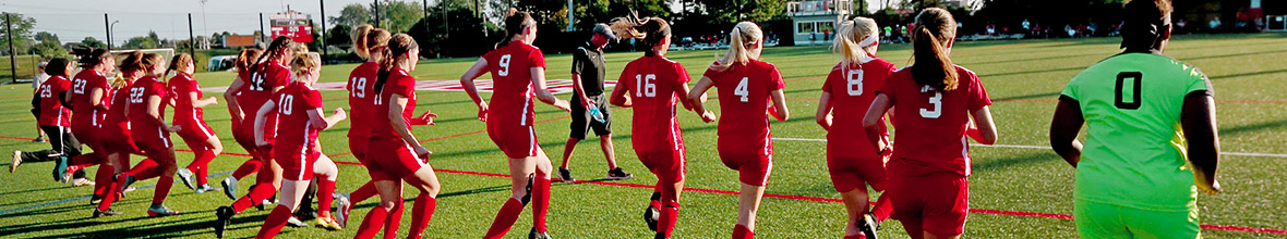 The D'Youville women's soccer team runs out onto Dobson Field.