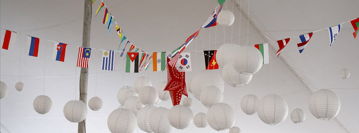 Flags of the world hang from a ceiling.
