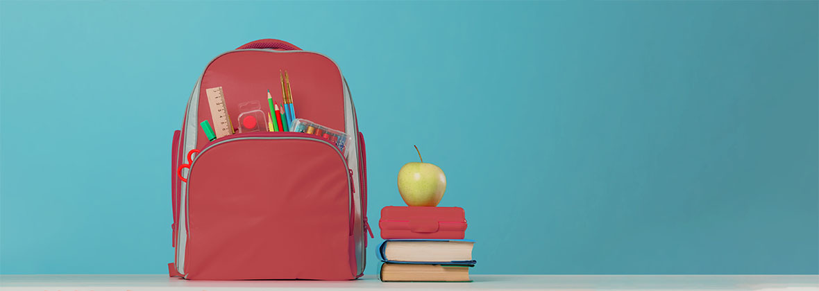 A backpack and an apple.