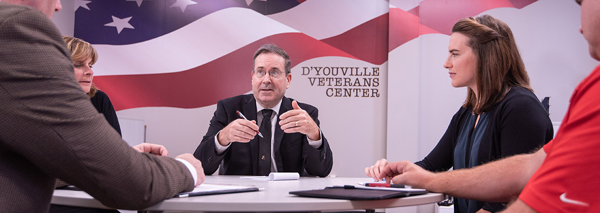 Staff members of the D'Youville Student Veterans of America hold a meeting.