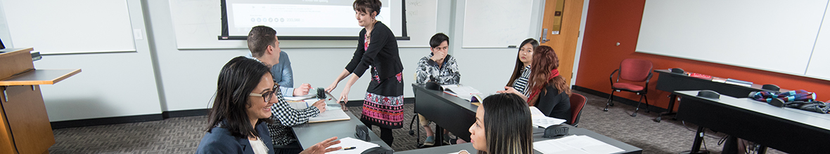 Laryssa Petryshyn teaching a class with international students.