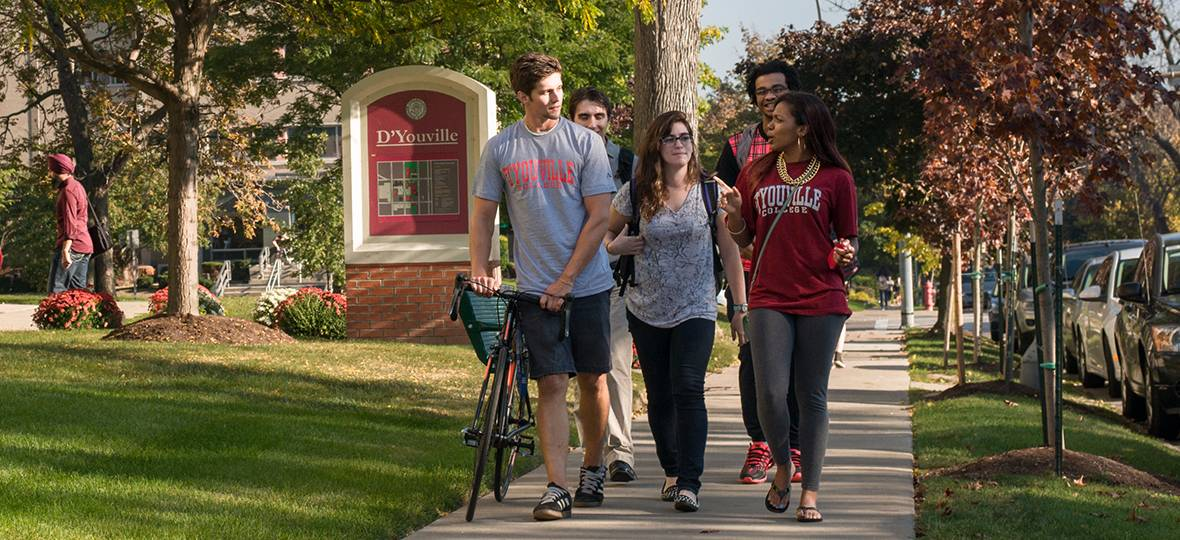 Students walk and talk on the D'Youville campus.