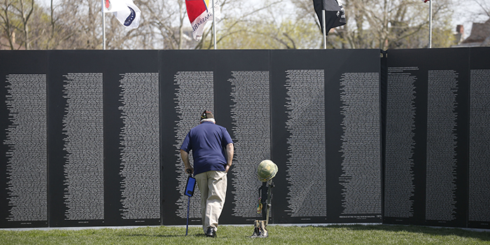 An onlooker examines the traveling memorial wall.
