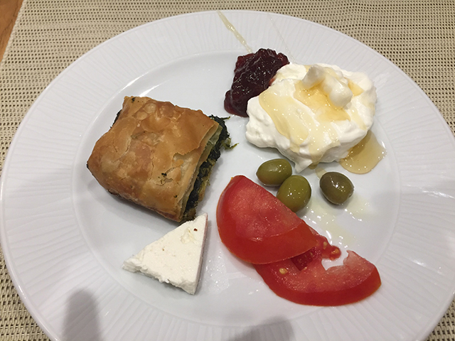 A sample breakfast at the hotel in Heraklion included spinach pie, yogurt, honey, cherries, olives, tomatoes, and fresh mizithra cheese (goat cheese).
