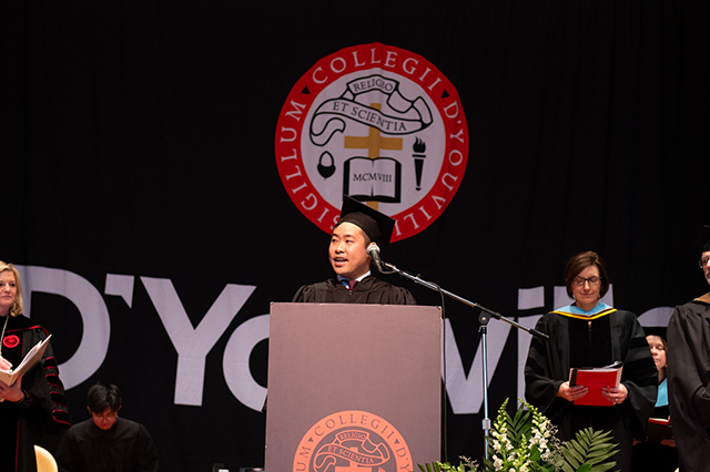 Johnny Qiu addresses the audience at Honors Convocation