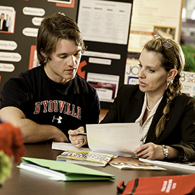 Photo: A D'Youville student receives career advice.