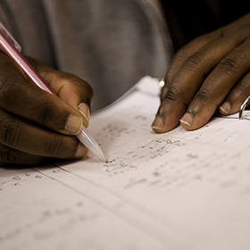 Photo: A student works on a math problem.