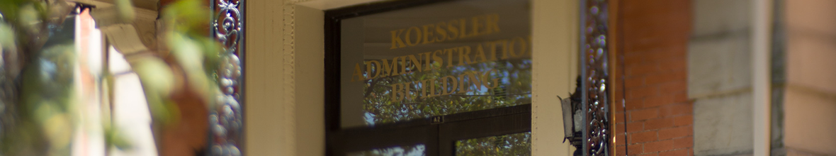Glass sign on the Koessler Admin Building