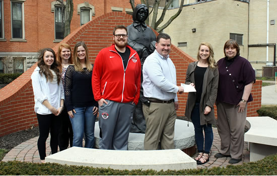 HSA students present check to Friends of the Night People director