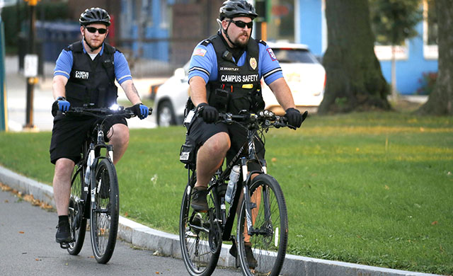 Officers partolling the D'Youville grounds on bicycle.
