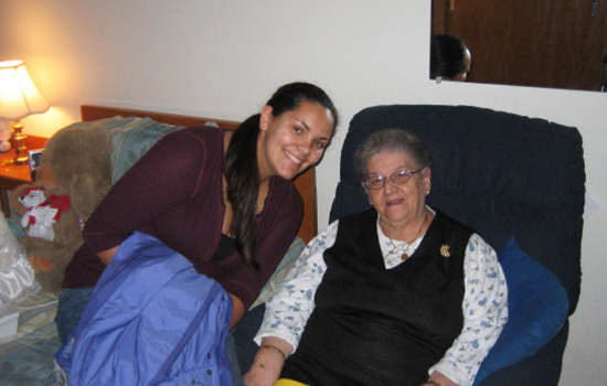 A student connecting with a senior resident at Mary Agnes Manor.