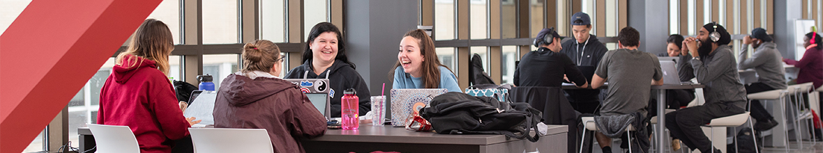 Students socializing in the D'Youville Academic Center
