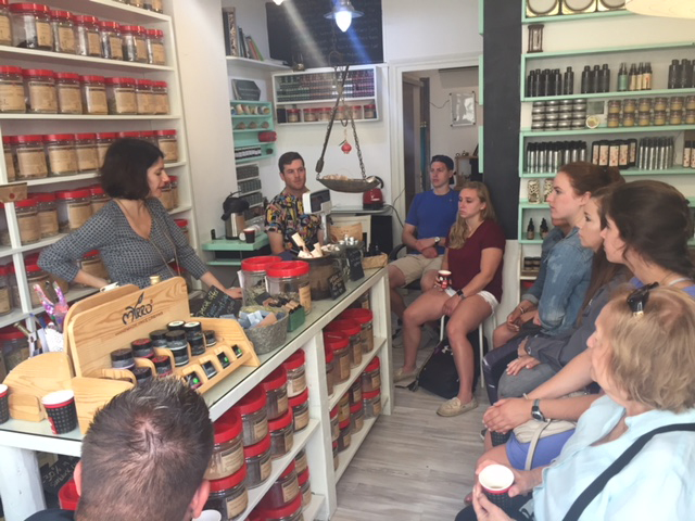 Students learn medicinal uses of natural herbs at an apothecary in Archanes.