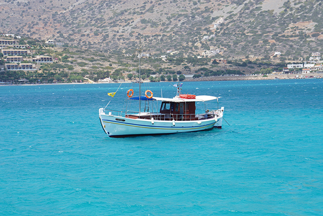 A boat anchors just off the picturesque coast of Elounda, a short distance from Plaka.