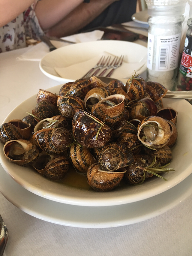 Cretan cuisine includes snails such as these cooked with olive oil and rosemary.