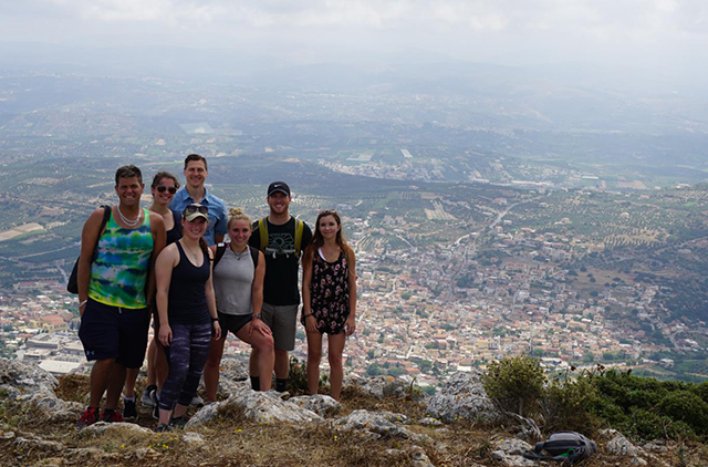 The group takes in the view at the top of Mount Juktas.